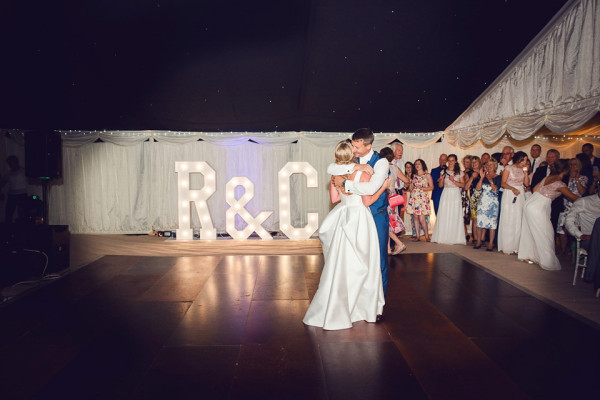 Dancefloor and light up letters at Stoke Place open air Wedding