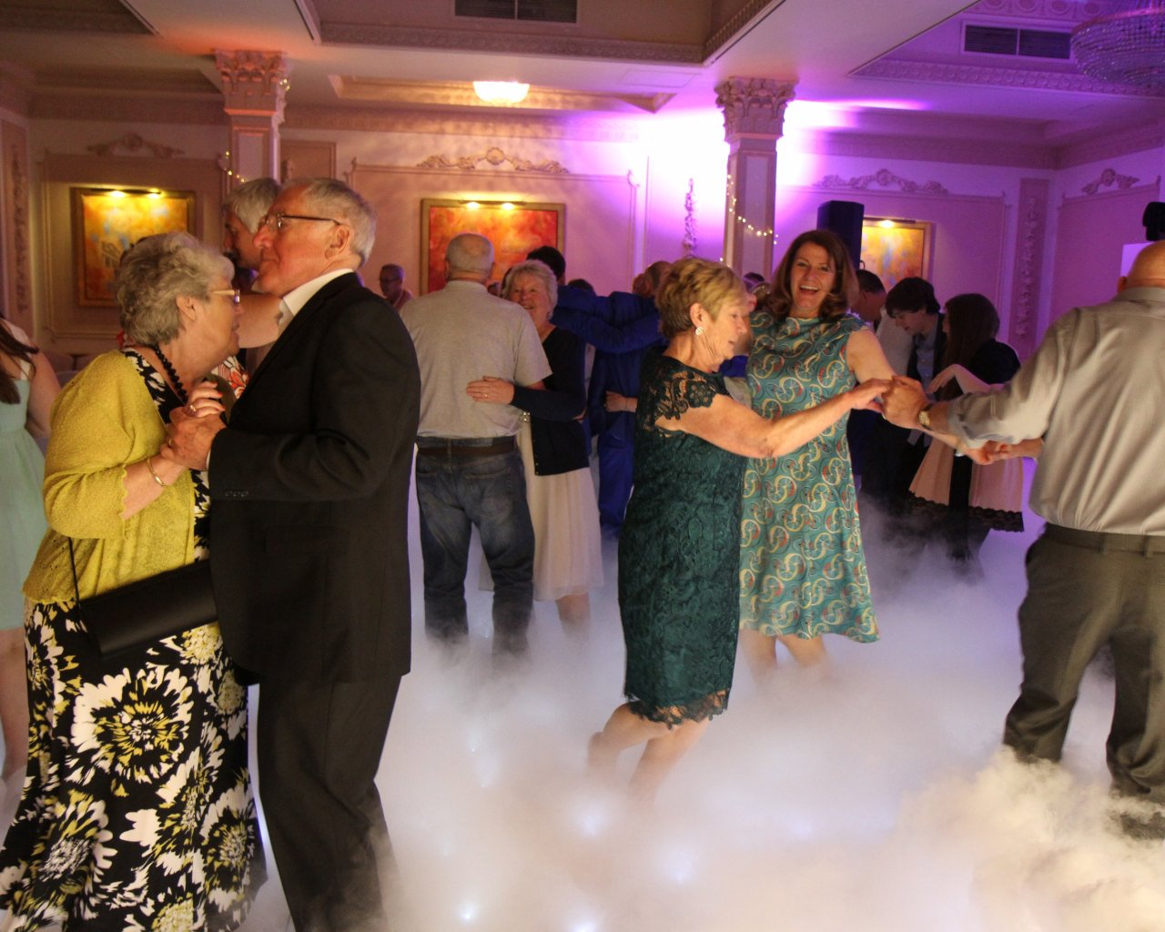 Dancing on the clouds through a starlight white led dancefloor with uplighting