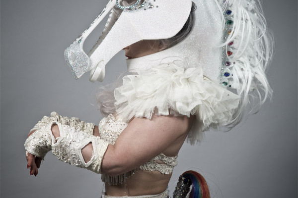 A Burlesque Artist poses in a Horse Head Costume whilst waiting to go on stage at a party