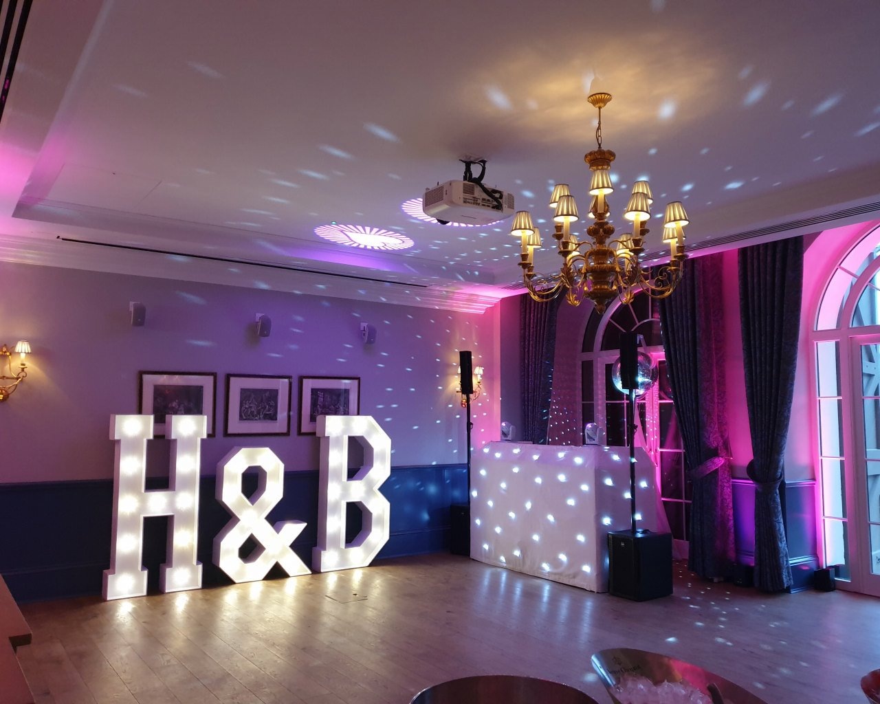 DJ set up Disco Ball and large light up letters at a Cliveden House wedding